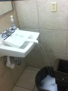 "Fill a bucket at a sink, using a dustpan. Genius! This is from the ""Non-Obvious Solutions"" site."