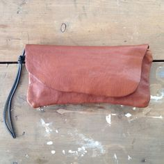 handmade leather natural edge clutch / by elke
