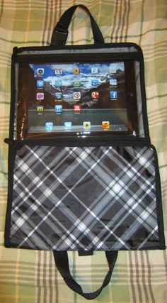 Thirty-One Gifts, 31 Gifts,   Timeless Beauty Bag with an i-pad 2 in it.  Touchscreen still works thru the plastic.