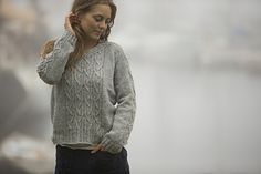 Love this pattern from Swans Island All American Collection.  See Ravelry listing for the cable that runs up the sleeves and across the back.  Great concept.