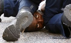 This Week in PicturesA man protesting the shooting death of Alton Sterling is detained by law enforcement near the headquarters of the Baton Rouge Police Department in Baton Rouge, Louisiana, US. Baton Rouge Protest, Baton Rouge Police, Religion, Powerful Images, Iconic Photos, Pictures Of The Week, Photojournalism, Black History, Louisiana