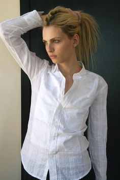 Andrej Pejic holding hair back.