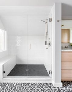 A huge master shower with white subway tile