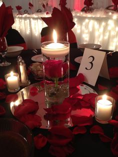 Lukas Wedding. Red Rose Centerpiece with floating candle. By Breezewood Floral