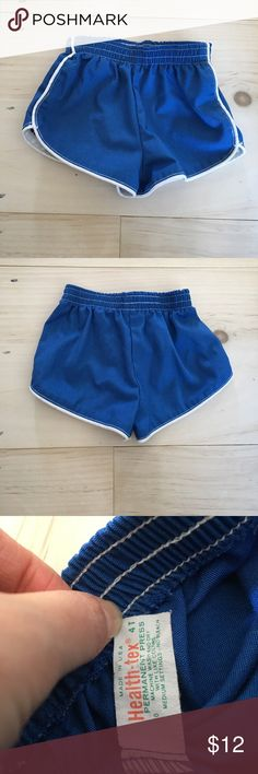 Vintage 70s Blue Running Shorts 3t Amazing vintage gym shorts. Super short, white trim and side stripe. Elastic waist. EUC. Tag says size 4t, which if your child is very lean then I would say yes to 4t but IMO I think they fit like today's 3t, still short and tighter, would not fit over a diaper. Health-tex Bottoms Shorts