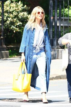 Leggy lady:Her gorgeous gams were wrapped in a pair of faded denim pants that held a form fitting design