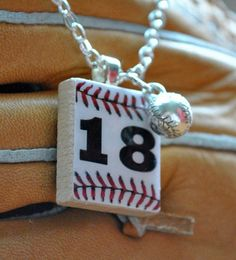 My daughter in law sells these!  Darling! Homerun Necklace by lulustiles on Etsy, $10.75