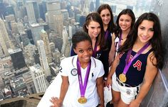 Kitted out: Aly Raisman, Gabby Douglas, McKayla Maroney, Kyla Ross and Jordan Wieber posed with their medals on top of the Empire State Building