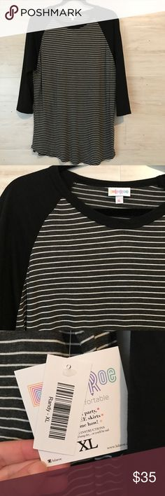 NWT LuLaRoe Randy Tee Black with white stripes on the body. Stretchy cotton texture. Size XL. NWT never worn! Bundle to save or make a reasonable offer 💕 LuLaRoe Tops