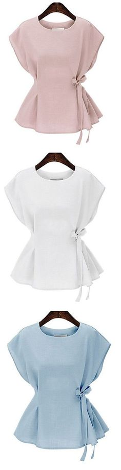 Such a delicate women's top! The bow at the waist is simply adorable! Perfect…