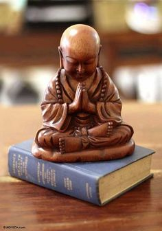 Wood sculpture, 'Little Buddha Praying' by NOVICA. I saw one at Garland Of letters in Philadelphia, and I was so drawn to it.