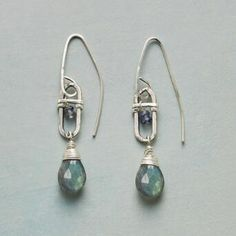 Indulge in the dreamy hues that shine from these sterling silver, labradorite and iolite dangle earrings.