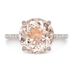 This stunning 3.75 ct. morganite and diamond engagement ring will sweep her off her feet. Bright and beautiful center stone is eye clean. Simple rose gold shank encrusted with diamonds. Huge, beautiful round cut morganite grasped with diamond set prongs.