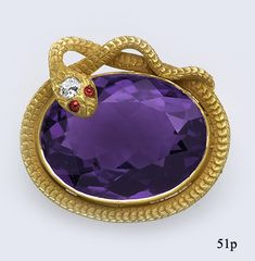 A Siberian amethyst, diamond, ruby and gold snake brooch. (Nelson Rarities, Inc)