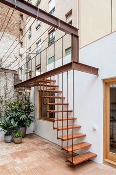 Staircase, Metal Railing, and Wood Tread Photo 14 of 14 in A Dramatic Apartment Renovation in Barcelona Features Salvaged Tile and Brick Staircase Outdoor, Modern Staircase, Staircase Design, Staircase Metal, House Stairs, Facade House, Exterior Stairs, Interior And Exterior, Facade Design