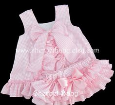This classic RUFFLED pinafore sunsuit/sundress and diaper cover is precious in your choice of gingham colors - available in purple, yellow, red, pink, hot pink, lime green, blue or your request. Ruffles Ruffles Ruffles! Your choice of color in gingham checks. Monogram not included but available for a small additional fee. Both pieces are fully lined and made with top quality fabrics. Handmade to order and may be customized to your request. Pinafore: FULLY LINED pinafore which button...