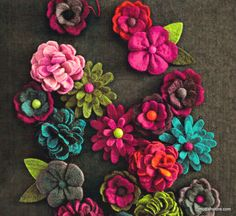 Rich tones of wool felt bloom into a variety of joyful flowers. Each set includes 20 different hand-crafted styles and colors. The happy blooms add floral beaut
