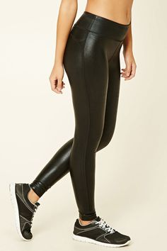 A pair of faux leather leggings featuring an elasticized waist and a hidden key pocket.