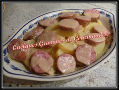 Saucisse de Morteau, pommes de terre et sauce au vin blanc