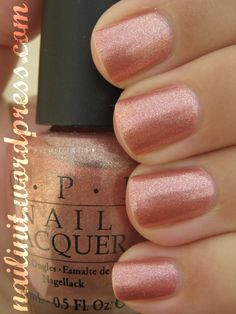"This week's mani pedi:  OPI's ""Coz-U-Melting In the Sun""  I have three coats, and it's a lovely pink with shimmer."