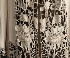 Detail of French coat trimmed with Irish crochet. Irish crochet played an important role in fashion. The quintessential Irish lace is Irish crochet, already famous in 1743 when the Royal Dublin Society awarded prizes for outstanding examples.