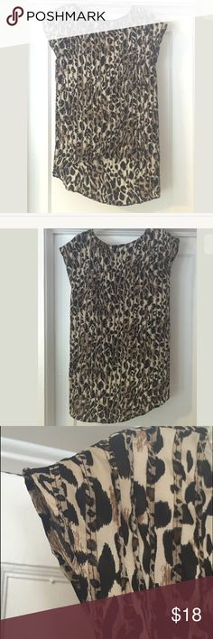 Glam Boutique Hi-Lo Leopard Print Short Sleeve Top Glam boutique short/cap sleeve blouse with high low hem, leopard print. 100% Polyester. No signs of wear. Size Small. Glam Tops Blouses