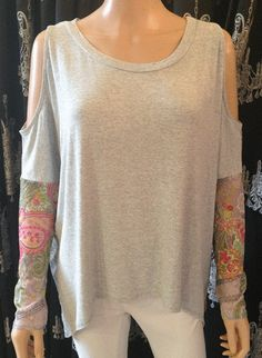 A Postcard From Brighton Online Ladies Clothes Shopping Range. Look and feel amazing in this gorgeous paisley print peek a boo top. A must for Summer!