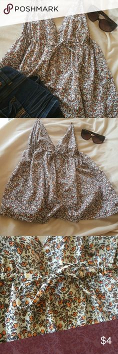 Gap top Really cute floral pattern summer top. Elastic in the back, ties in the front under the breasts, an has adjustable straps. and for the length i would say it comes right down  to the waistline.  Only flaw is a little bit of unraveling on left side of the top see last pick for details :) size L Gap  Tops Tank Tops