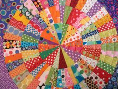 I want to make this circle quilt.  What a fun way to use up colorful scraps!