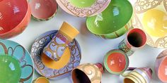 Liz Kinder. I love her stuff! Want a set of mugs.. then the bowls and the plates and all of it!