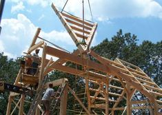 Raising a 'section' of this compound joinery timber frame roof into place near Franklin, NC. Metal Roof Houses, House Roof, Joinery, Franklin Nc, Timber Frames, Construction, Exterior, Gallery, Raising