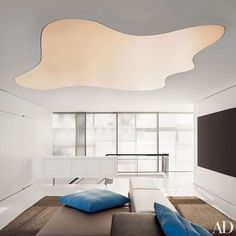 The upstairs play area of a lakefront Chicago home by Peter Gluck features a custom-made biomorphic ceiling light.