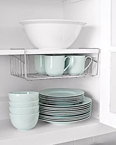 Slip this wire rack on a shelf to take advantage of the often-unused space below. containerstore.com