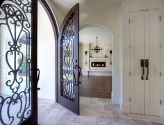 An example of a Tuscan entryway designed with Travertine and fantastic wood door. #travertinetiles