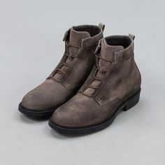 Hand-crafted leather boots made in Italy. Waxed suede upper on the outer and a calfskin lining. Indents on the upper are intended for wrapping laces around the ankle and speed laces ensure a snug fit.