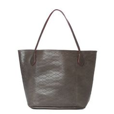 A wide and roomy unlined vacchetta leather tote, made to soften and age beautifully. A classic, this bag will take you through years of commutes, busy weekends, and market runs. In smooth seagull vacchetta leather perforated with the MZ Wallace signature diamond pattern.