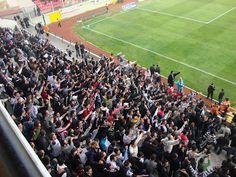 football hooligans singing drunkenly in the stadiums!