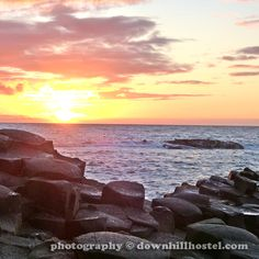 Sunset at the Giant's Causeway County Antrim Northern Ireland by downhillhostel.com http://www.downhillhostel.com/wp-content/uploads/2012/07/giants_causeway_hostel_sunset_photography_7-copy.jpg
