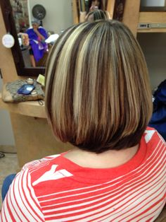 Back view of chunky highlights and lowlights. Cut into a line bob by Sarah Romero