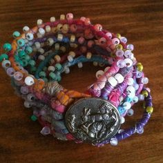 fabric cords with beads and bunny button bracelet   Flickr - Photo Sharing!