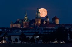 1st August 2015 The Full Moon rising over Wawel Castle in Kraków, Poland.