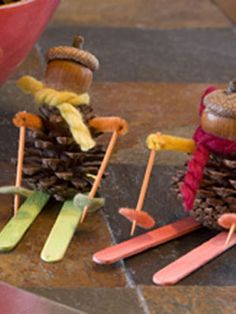 Pine cone body, acorn head, Popsicle stick skis, and toothpick ski poles. Add some felt for decorations.