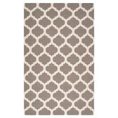Handmade flatweave wool rug with a quatrefoil motif in taupe and white.       Product: Rug    Construction Material: 100% Wool    Color: Taupe and ivory    Features: Hand-wovenFlatweaveMade in IndiaReversible          Note: Please be aware that actual colors may vary from those shown on your screen. Accent rugs may also not show the entire pattern that the corresponding area rugs have.Cleaning and Care: Blot stains