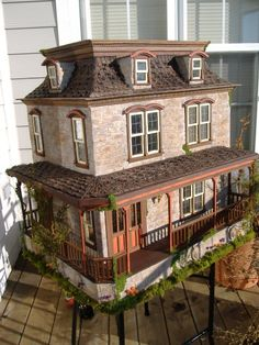 """This is a """"Bashed"""" (which means edited) Lily dollhouse kit from Greenleaf dollhouses that the blogger did a few years back. It ended up on the front cover of the """"Dollshouse & miniature scene"""" Magazine."""