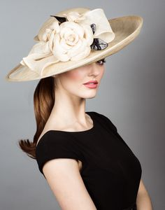 Natural straw sidesweep hat with hand tooled straw camellias.