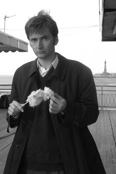 I never knew the Doctor to look so serious while eating cotton candy... How can you look so serious?!