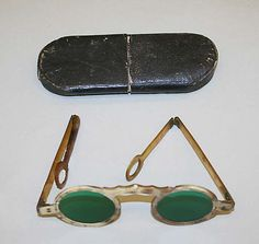 Spectacles, 19th C. Italian, horn frames, tinted glass, leather case, in storage at the Met.