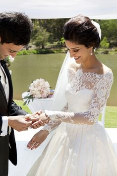 brides of adelaide magazine wedding dress lace. i like the picture of putting the ring on her finger :)