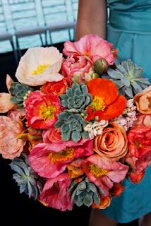 orange and coral bouquet of succulents, poppy and roses.