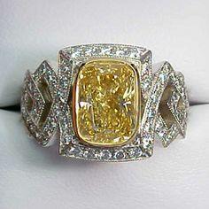 Intense Yellow Cushion Cut Diamond Art Deco Ring, set in 18 karat white and yellow gold.